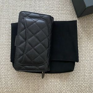 CHANEL Bags - Chanel wallet black caviar, new with tags